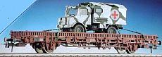 Roco 47398 - Kbs 442, Rungenwagen mit Bremserbuehne, beladen mit SAN-UNIMOG in WINTER-Tarnfarbe.2